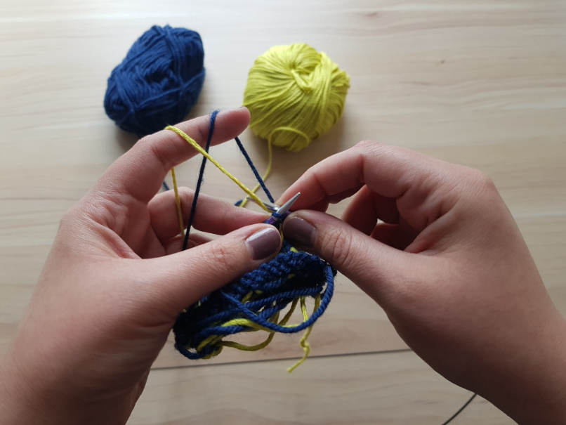 yarn tension - Both strands held with my left index finger. I prefer this for double knitting, though.