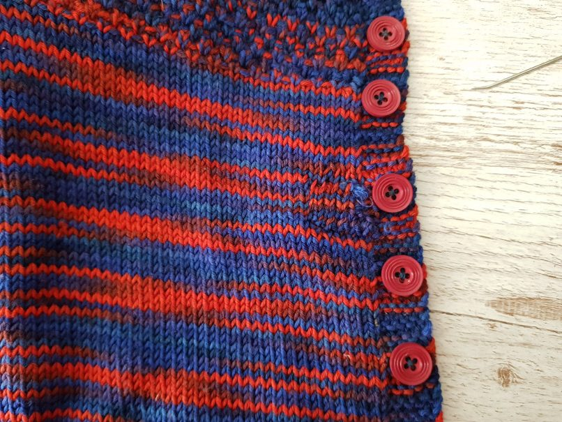 darn knits - Knitted patch on the front of a cardigan. In solid yarn it would blend in more but even like this it looks pretty neat.